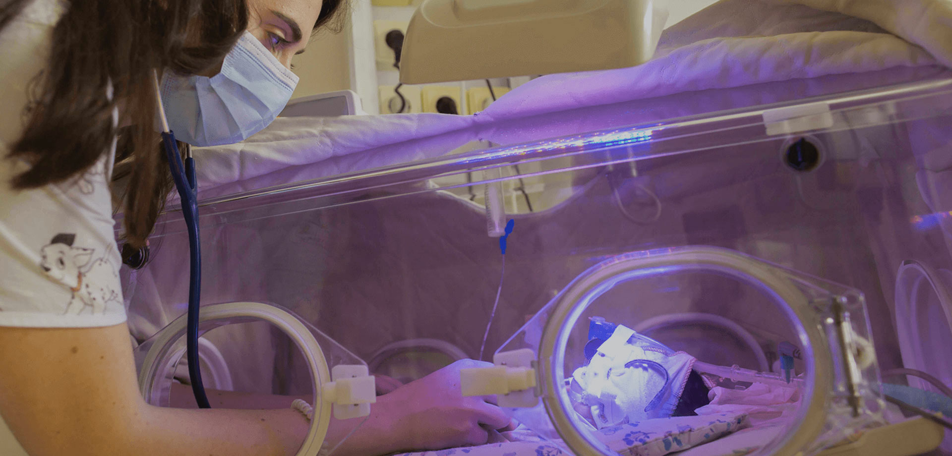 Doctor assisting a preterm infant in the Neonatal Intensive Therapy Unit